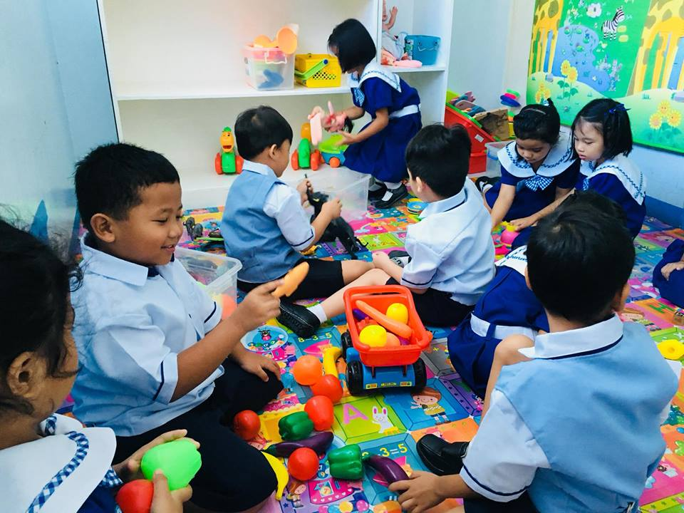 Senior Kinder students during their play time before the start of their class.